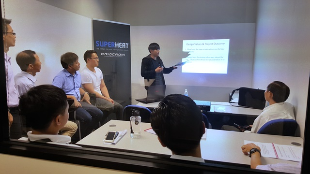 Temasek Polytechnic student doing a presentation in Superheat office